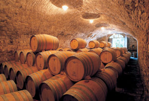 Barriques in one of the cellars located beneath the original buildings of Volpaia