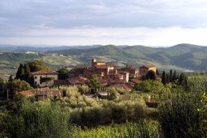 The village of Volpaia at springtime, with Radda in Chianti in the distance